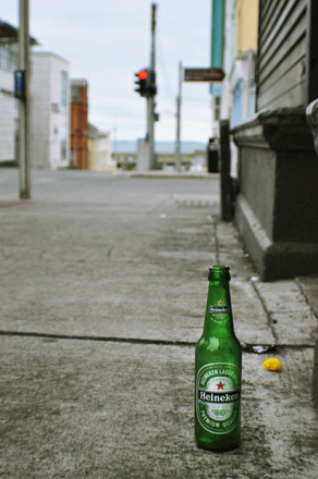 Heineken bottle on a sidewalk in Ireland