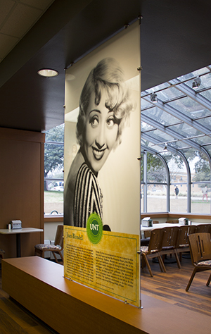 8 foot tall acrylic screen featuring Joan Blondell's photo and bio.