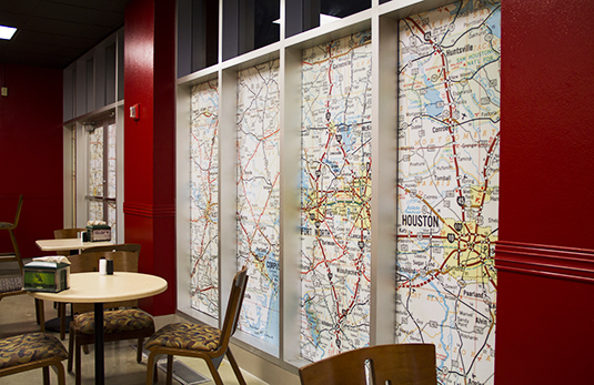 Vintage Texas roadmaps were enlarged and used to block off windows to an exterior room.