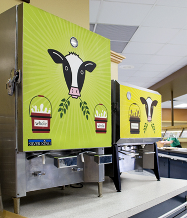 Milk machine graphics with illustrated cows