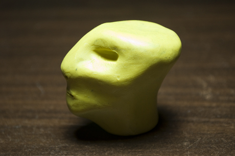 Clay sculpture of an alien-like head
